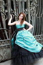 Red haired girl in the beautiful blue dress Royalty Free Stock Photo