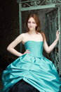 Red haired girl in the blue dress Royalty Free Stock Photo