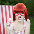 Red haired girl chewing gum Stock Images