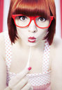 Red haired girl chewing gum Stock Image