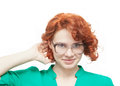 Red haired girl in glasses thinking isolated on white background Royalty Free Stock Photography