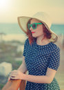 Red-haired girl in a hat and sunglasses Royalty Free Stock Photo