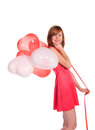 Red-haired girl in a pink dress with balloons Royalty Free Stock Photo