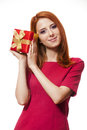 Red-haired girl with present box. Royalty Free Stock Photos