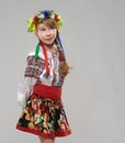 Red haired girl in slavic national costume dreams pretty the Stock Photos