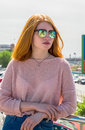 Red-haired girl is in sunglasses Royalty Free Stock Photo