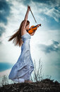 The red-haired girl with a violin Royalty Free Stock Photography