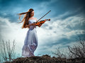 The red-haired girl with a violin Royalty Free Stock Photo