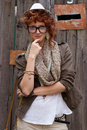 Red haired hipster girl posing Royalty Free Stock Images