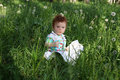Red-haired little boy in grass Royalty Free Stock Photos