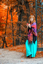 Red haired woman in the autumn park a cast iron gates Royalty Free Stock Photos