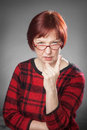 Red haired woman portrait facial expression wag a finger studio on gray Stock Images