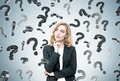 Red haired woman and question marks Royalty Free Stock Photo