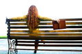 Red - haired woman sitting on bench with book