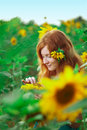 image photo : Red-haired woman with sunflowers