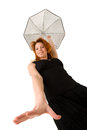 Red haired woman with umbrella looking down in black dress Royalty Free Stock Images