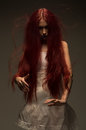 Red haired zombie woman in white cotton dress Royalty Free Stock Photo