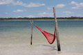 Red hammock single at jericoacoara brazil Royalty Free Stock Photography