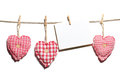 Red handmade hearts with blank card hanging on clothes line Stock Photo