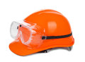 Red hard hat and goggles redhard on white small natural shadow under object Stock Photos
