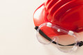 Red hardhat and protective glasses workwear for construciton workers Stock Photo