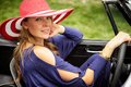 Red hat classic car wealthy attractive woman exits her sports Stock Photography