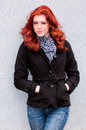 Red head in blue jeans Royalty Free Stock Photo