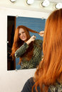 Red head cut hair mirror Stock Images