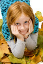 Red head girl laying in autumn leafs Stock Image