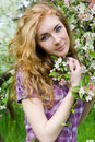 Red-headed woman under cherry tree Stock Photos