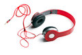 Red headphones on white background Royalty Free Stock Images