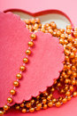 Red heart with beads Royalty Free Stock Photography