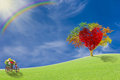Red heart with big tree on meadow Royalty Free Stock Photo