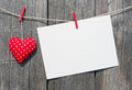 A red heart and a blank card with copyspace on a wooden background Stock Photos