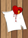 Red heart bleeding on note Royalty Free Stock Photo