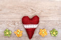 Red heart and blossoms of cloth on a weathered wooden board Royalty Free Stock Images