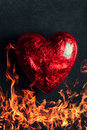Red heart burning on a black background Royalty Free Stock Image