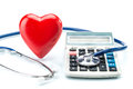 Red heart and calculator with stethoscope on white background Royalty Free Stock Photo