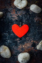 Red heart in circle of rocks Royalty Free Stock Photo