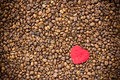 Red heart on coffee beans background love concept Stock Photography