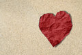 Red heart crumpled paper on sand texture, beach lover texture background Royalty Free Stock Photo