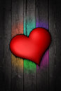 Red heart in a dark wood background Stock Photos
