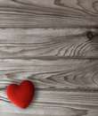 Red heart on dark wooden planks valentine s day background with Stock Image