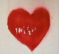 Red heart on a decaying wall an white love concept Royalty Free Stock Photos
