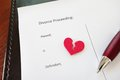 Red heart divorce document with broken and pen Royalty Free Stock Image