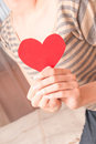 Red heart in female hands beautiful fingers bedroom love sensuality tenderness concept Royalty Free Stock Photo