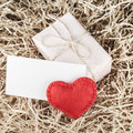 Red heart and gift box on sawdust vintage style Royalty Free Stock Image