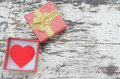 Red heart in gift box on wood background in vintage style Royalty Free Stock Photo