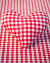 Red heart on gingham tablecloth Stock Images