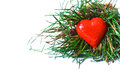 Red heart in grass a wicker basket with green Royalty Free Stock Photo